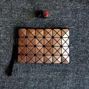 Handbags - NWT GOLD & BLACK GEOMETRIC CLUTCH